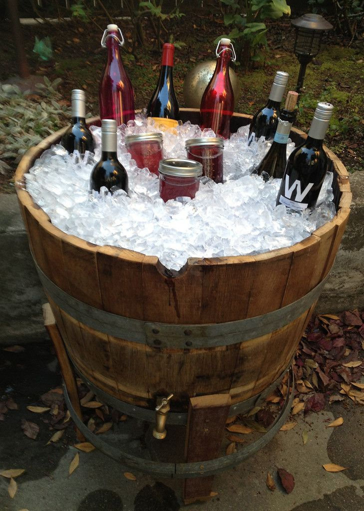 This is an authentic french oak wine barrel from Sonoma and Napa Valley Vineyards in California. We have re-used the wine barrels and cut them in half to make them into the cooler. The inside is lined with black polyurethane and the metal spigot allows for easy draining. The base is made from wine barrel staves. This is perfect for entertaining friends and family on your porch, balcony, garden, etc .... Quantity: 1 Weight: 51 pounds Ships from: Sonoma, CA Ship within the continental USA