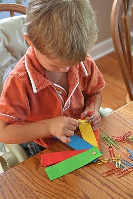 colored paper clips on laminated construction paper strips