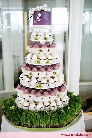 Love this idea of a cupcake wedding cake! Love the cake for the bride and groom on top. :)