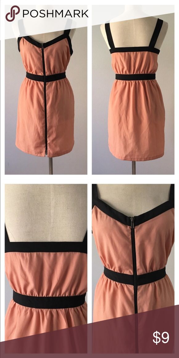 BNWOT Peachy Nude Zip Up Tank Tunic BNWOT Peachy Nude Zip Up Tank Tunic. Size large would fit a 10-12 best. Please see pictures. Thank you for looking at listing. Feel free to ask questions :)!   ✨⭐️️Bundle and save!⭐️✨10% off 2 items, 20% off 3 items & 30% off 5+ items!   •Sorry no trades. •No modeling. •No Low balls 🙅🏻 please and thank you! Forever 21 Dresses Mini
