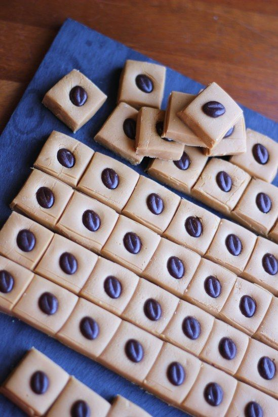 Coffee Fudge  - 397g tin condensed milk  – 150ml milk  – 115g unsalted butter  – 450g demerara sugar  – 2 1/2 tablespoons Camp chicory & coffee essence  – Chocolate coffee beans, to decorate Line a 20cm x 20cm square dish with greaseproof paper. In a large saucepan on a medium heat, heat the condensed milk, milk, butter and sugar, stirring regularly, until the sugar has melted.  | 23 Incredible Coffee Desserts