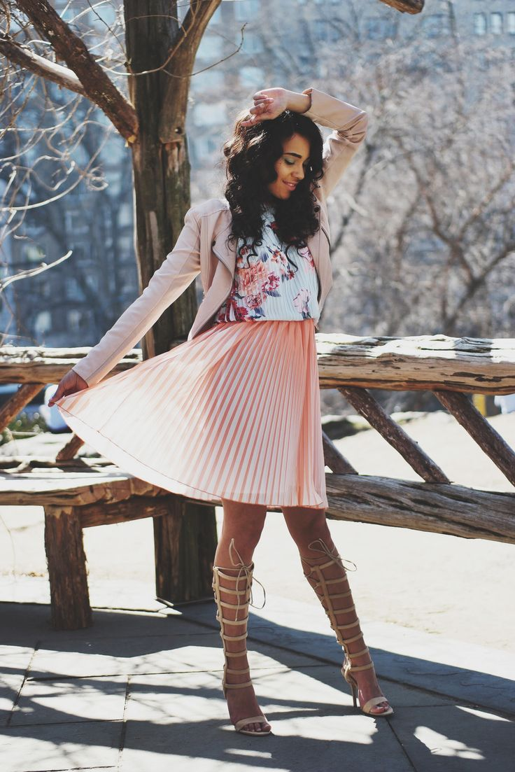 A rose pink leather biker jacket and dusty pink floral swing dress will convey a carefree, cool-girl vibe. Go for a pair of cream leather knee high gladiator sandals to va-va-voom your outfit.   Shop this look on Lookastic: https://lookastic.com/women/looks/pink-leather-biker-jacket-pink-floral-swing-dress-beige-leather-knee-high-gladiator-sandals/18807   — Pink Leather Biker Jacket  — Pink Floral Swing Dress  — Beige Leather Knee High Gladiator Sandals