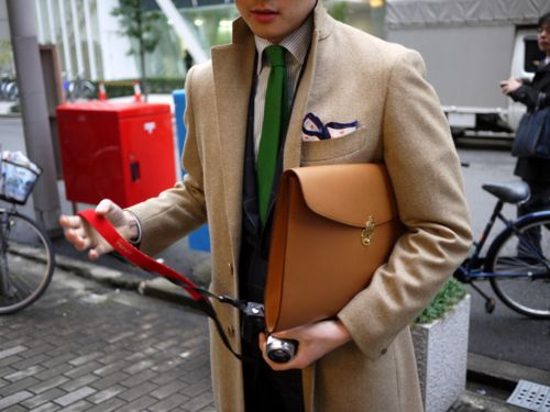 Kelly green tie and a pocket square in the overcoat