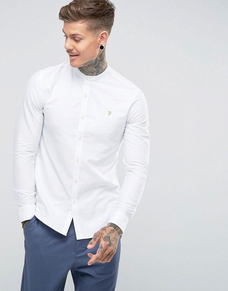 Get this Farah's basic shirt now! Click for more details. Worldwide shipping. Farah Brewer Slim Fit Grandad Oxford Shirt in White - White: Oxford shirt by Farah, Breathable cotton, Grandad collar, Embroidered Farah logo, Button fastening, Slim fit - cut close to the body, Machine wash, 100% Cotton, Our model wears a size Medium and is 191cm/6'3 tall. From their birth in the 1920s, Farah has been adopted by subcultures across the board; from Mods to Skins and Rockabillies. Renowned for their…