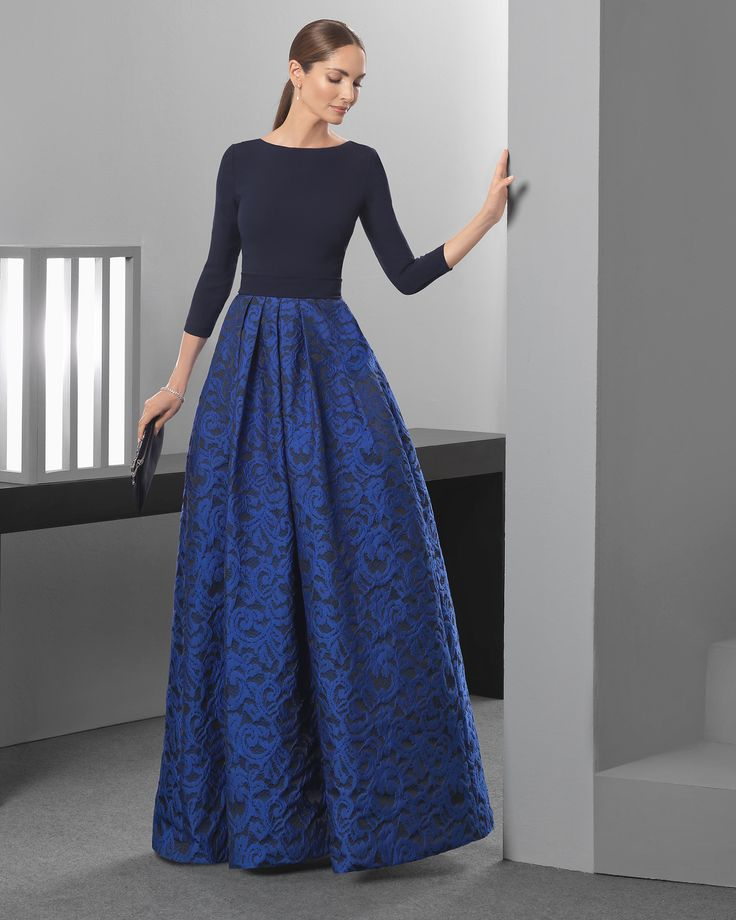 Classic long tailored dress with crepe bodice, V-neckline, long sleeves and brocade skirt, in coral, blue and cobalt.