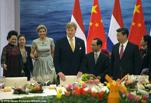 Queen Maxima and King Willem-Alexander are shown to their seats at the grand banquet in Beijing