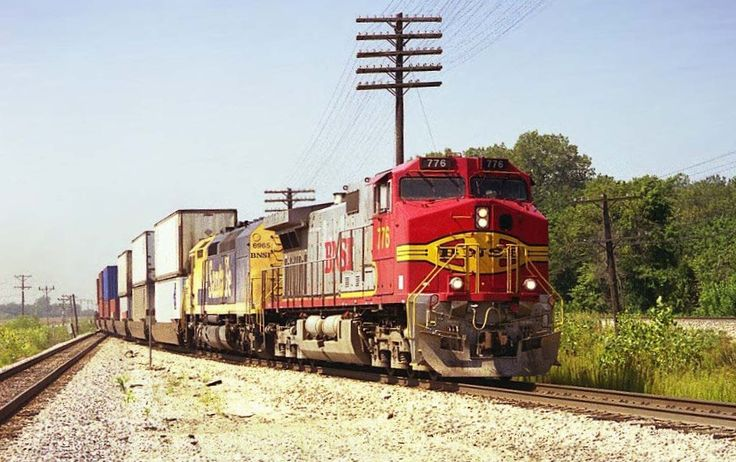 https://flic.kr/p/DJTvuj | BNSF C44-9W 776 | Late 90's BNSF Eastbound Doublestack Train passes through Carrollton, MO with BNSF Warbonnet C44-9W 776 leading a yellow & blue Santa Fe SD40-2F