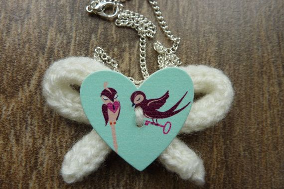 White and blue necklace with birds