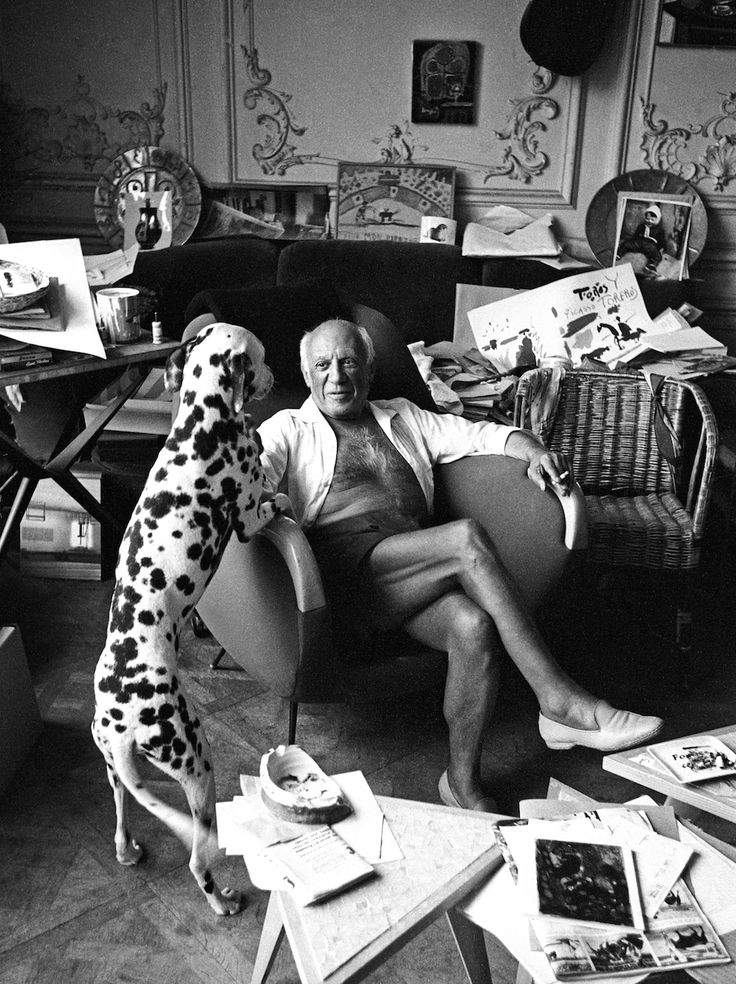 Picasso and his dog Pero, Cannes 1961 by ©Edward Quinn