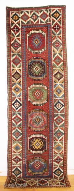 antique moghan long rug with absolutely beautiful natural colors and overall good condition for a genuine old rug. Bold and eye catching design. Lovely greens, aubergine, golds and a pretty yellow. Washed  ...