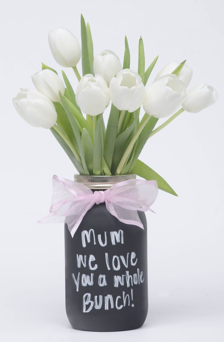 Getting Mum flowers for Mother's Day? Create your own vase with Rust-Oleum Chalkboard Paint and an old mason jar. It adds a personalized touch Mum is sure to love!