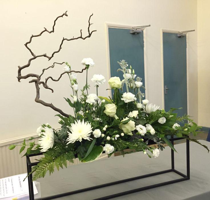 FLOWER ARRANGEMENT: Winter of '64. FLOWERS: Cineraria, Contorted Willow, Fatsia, Palm, Carnation & spray Carnation, Staccis, Hosta, Lisianthus, Ayrum, Rose (Avalanche), Chrysanthemum (Anastasia), Honeysuckle. THEME: Memories. BY: on 21/05/2015