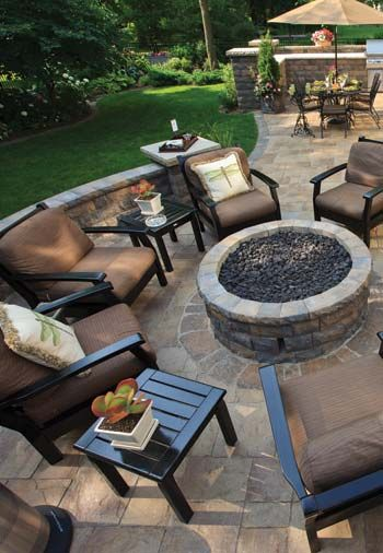 Paver patio with dining area and fire pit.  #firepits #patios homechanneltv.com