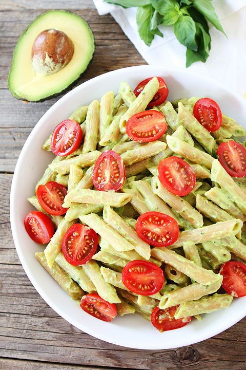 Avocado Goat Cheese Pasta Recipe on twopeasandtheirpod.com This simple and creamy pasta dish is full of flavor and can be made in under 30 minutes! It is a great weeknight dinner!