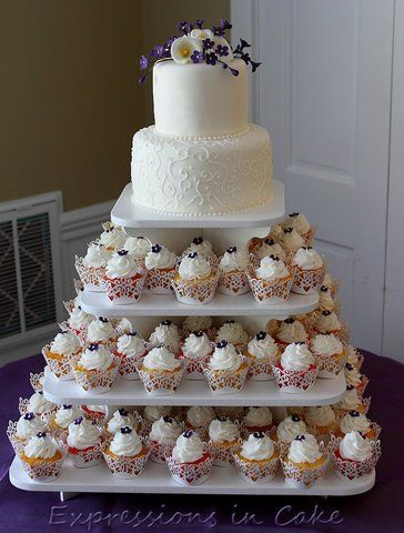 Cupcake Stand Ideas (I want a cake just to cut, then cupcakes for guests) So much easier, no plates needed. Much better idea!!