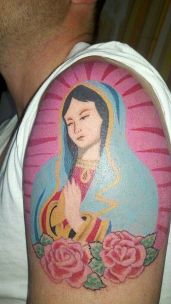 Not a fan of religious tattoos or symbolism by any means but I do enjoy the way this was put together. Unfortunately whoever posted this on fyeahtattoos didn't cite the artist : (