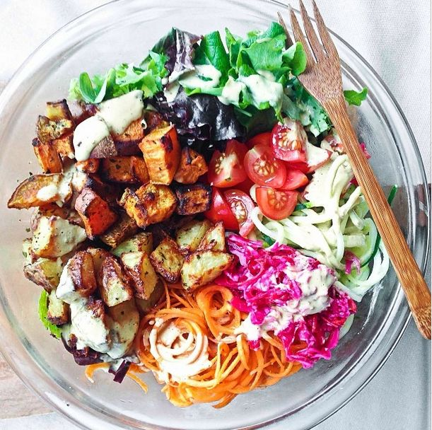 Roast potatoes seasoned with garlic/onion powder, parsley and coriander. Salad of mixed greens,cucumber and carrots noodles, cherry toms, sauerkraut with a peanut tahini dressing BY LONI JANE