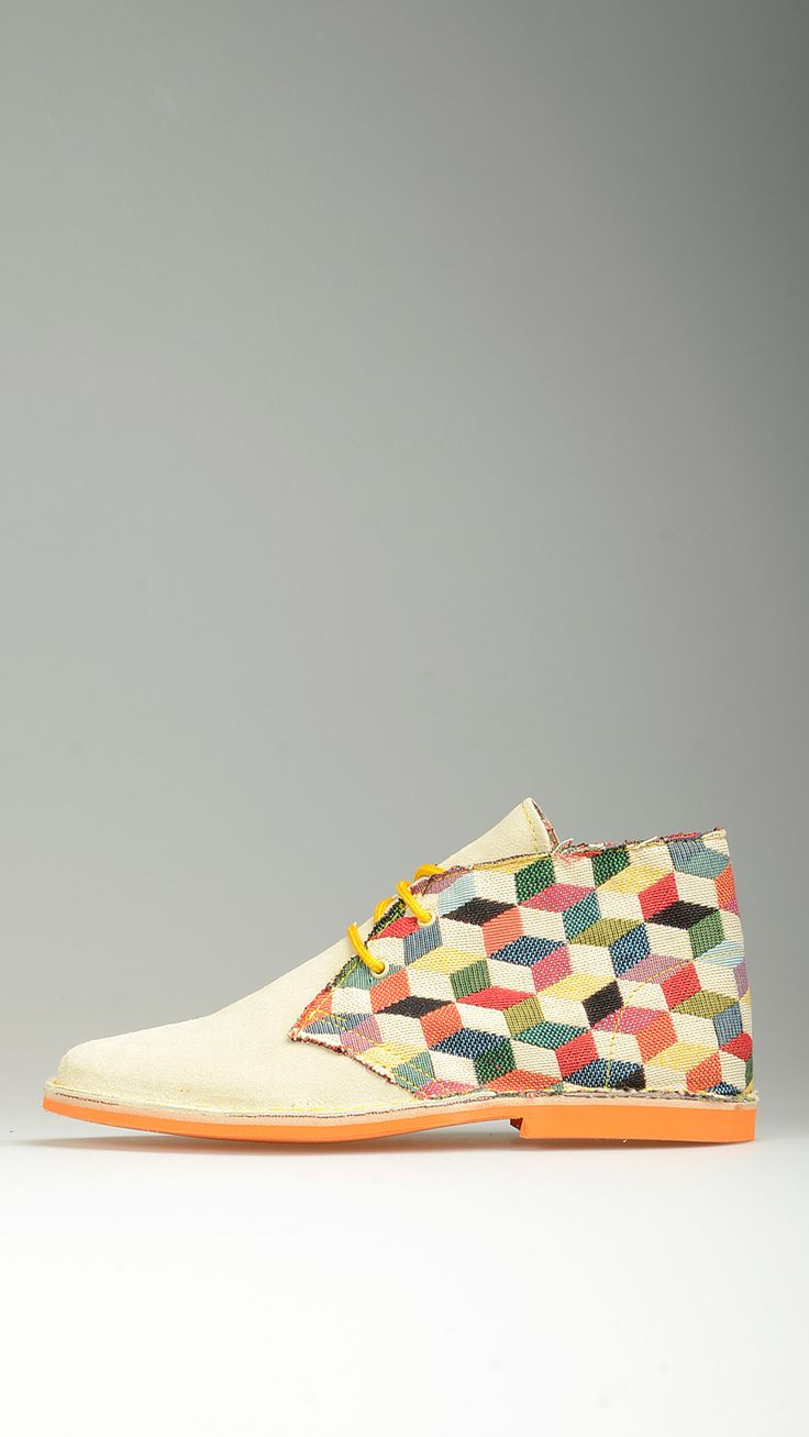 Multicoloured square canvas embellished natural beige suede lace-ups desert boots featuring contrast orange laces, lining, desert boots manufacturing process, contrast orange rubber sole, leather midsole, antioxidant eyelets, raw edge stitching, handcrafted garment, 100% finest suede and canvas.