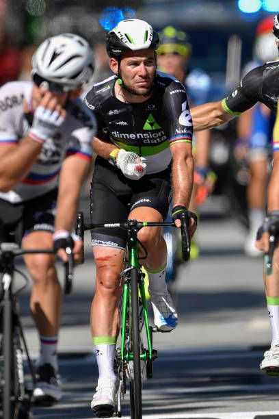 Great Britain's Mark Cavendish injured crosses the finish line after falling at the end of the 2075 km fourth stage of the 104th edition of the Tour...