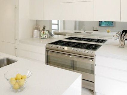 10 Ways To Use Mirrors To Make Your Space Look Larger Mirror Splashbackmirror Backsplashbacksplash Ideasglass Splashbackskitchen