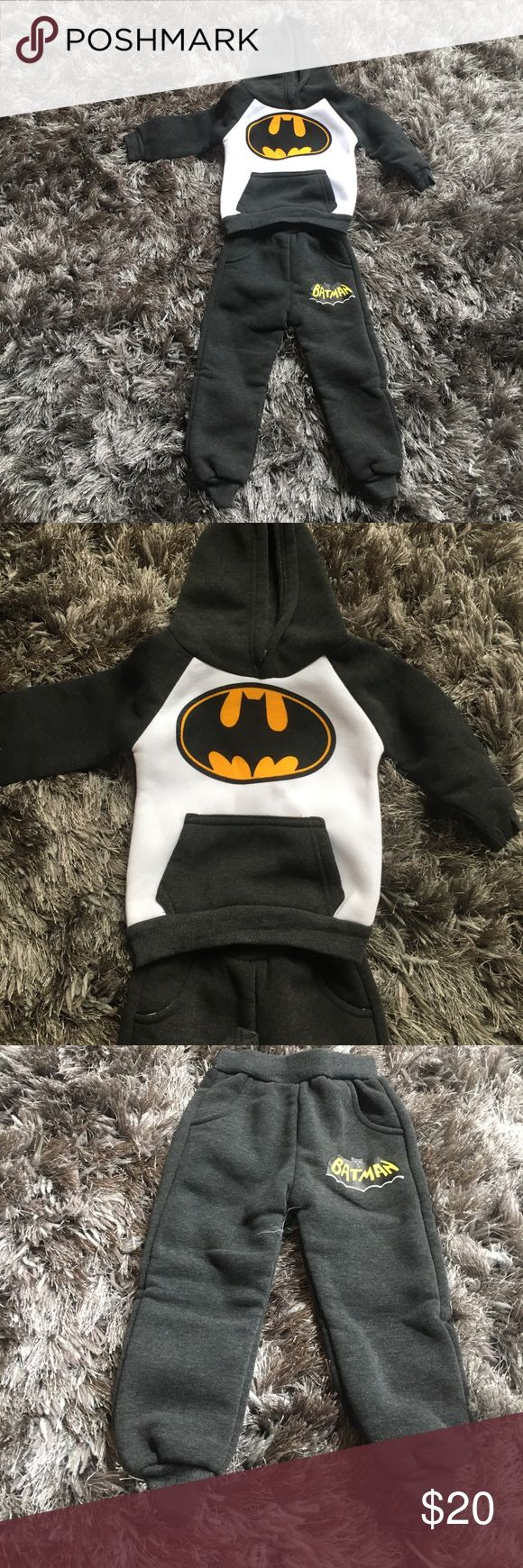 Brand new Baby boy grey and white batman suit NWT Grey  and white batman cotton suit for baby boy . Cute batman ears on the top of hoodie. 100 cm so it should fit 9-12 month baby Matching Sets