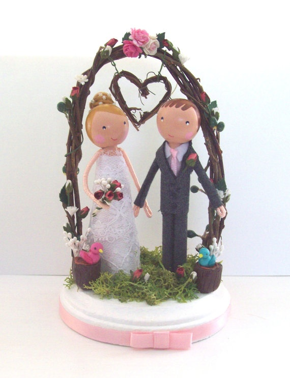 This is a customised wedding cake topper keepsake.  This woodland topper listing is for bride and groom, wood archway and two birds on tree stumps