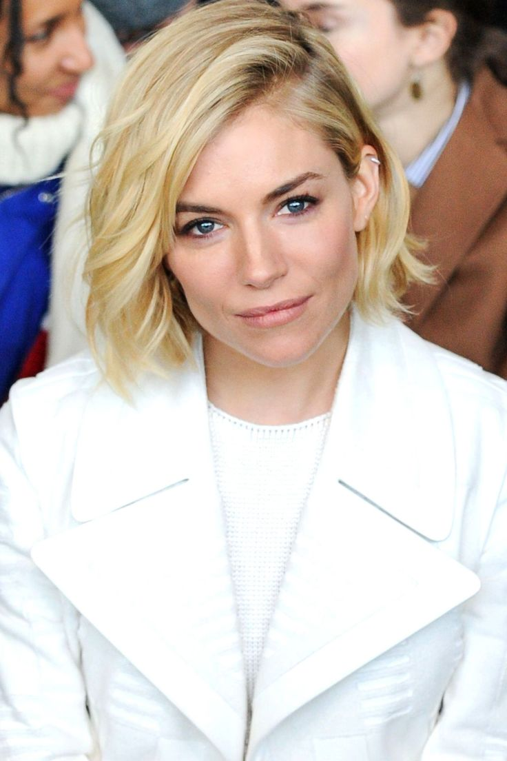 Short hair can be the hardest to keep in check at a festival but Sienna Miller shows how to style up a bob to look effortlessly chic at the Calvin Klein show, tousled and swept over in a side parting.