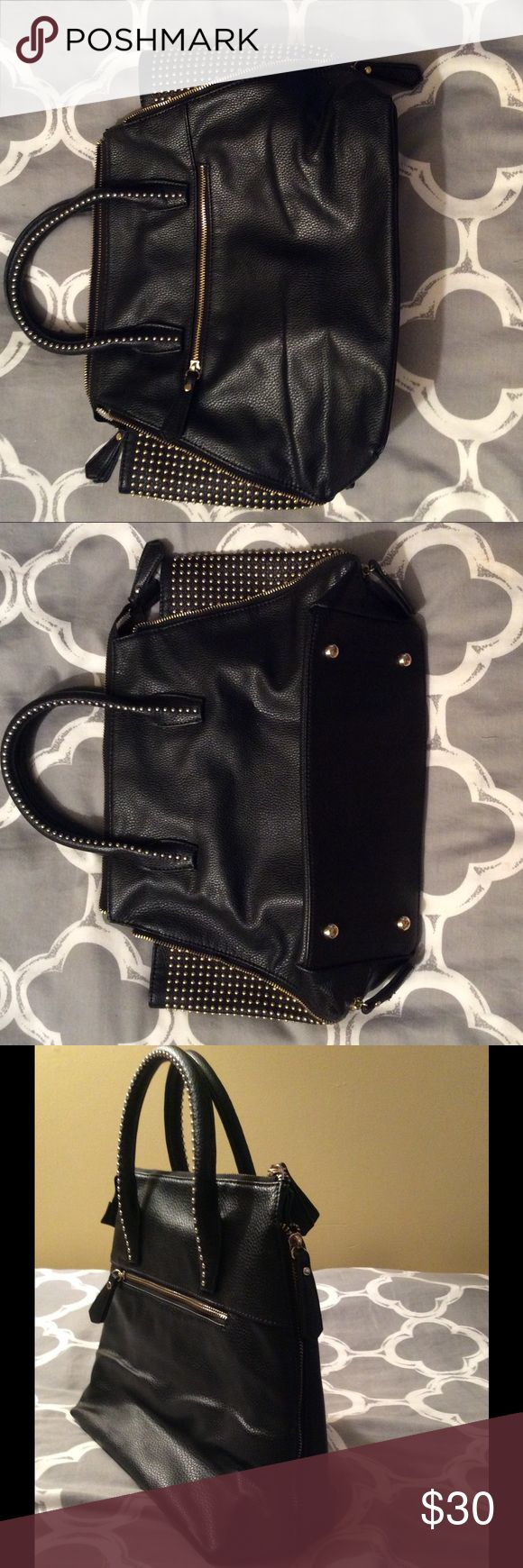 Charming Charlie-black stud zip purse Used, great condition. Sides zip up or zip down to expand with studded sides. Charming Charlie Bags Satchels