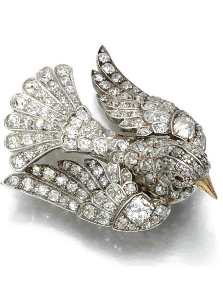A VICTORIAN RUBY AND DIAMOND BROOCH, LATE 19TH CENTURY. Designed as a roosting turtle dove, the eyes highlighted with cabochon rubies, the wings, body and tail set with cushion-shaped, circular-cut and rose diamonds, detachable brooch fitting. #Victorian #antique #brooch #DiamondBrooches