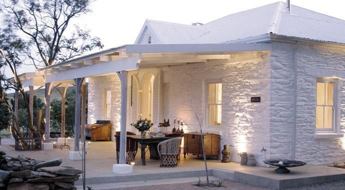 The whitewashed brick exterior, - A Whitewashed Villa in South Africa, Breezes Included by Julie Carlson