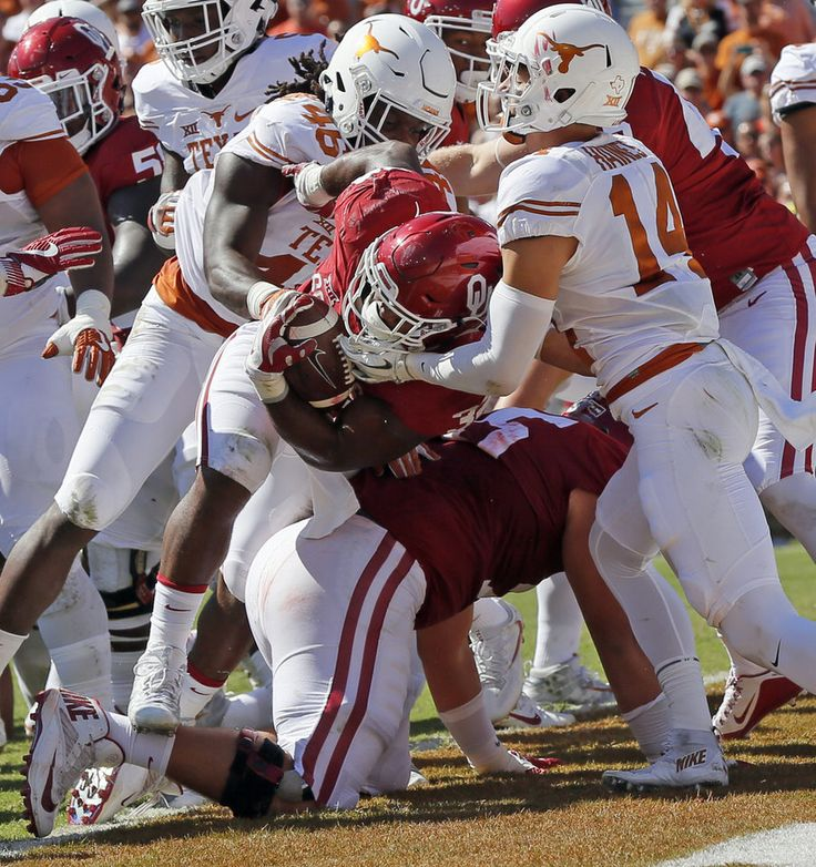 Oklahoma's Samaje Perine (32) scores a touchdown in the first quarter as Texas' Malik Jefferson (46) and Dylan Haines (14) defend during the Red River Showdown college football game between the University of Oklahoma Sooners (OU) and the Texas Longhorns (UT) at Cotton Bowl Stadium in Dallas, Saturday, Oct. 8, 2016. Photo by Nate Billings, The Oklahoman