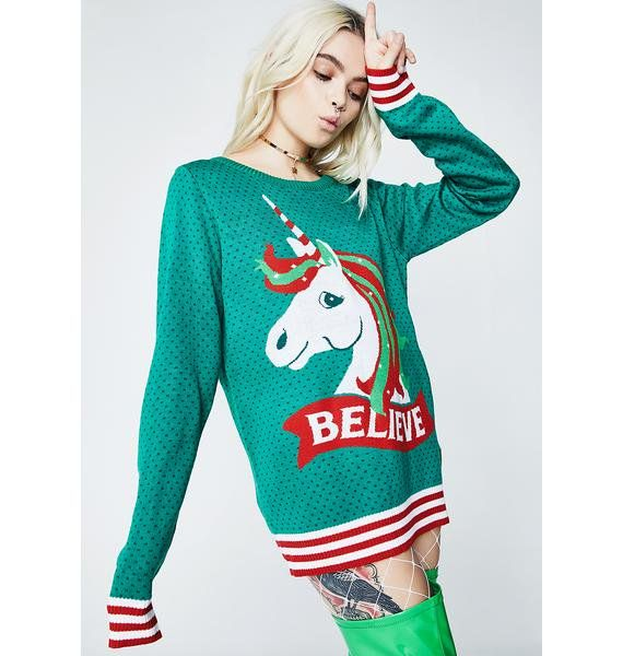 """Tipsy Elves Unicorn Believe Sweater do you believe in magic? This cozy dotted green sweater has a striped hem N' sleeves, and a majestic unicorn on the front with """"BELIEVE"""" text underneath."""