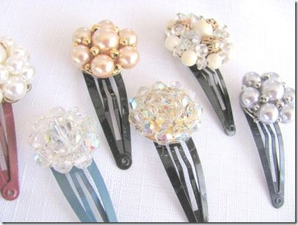 barrettes made from vintage jewelry.  Especially nice for earrings with no mates!