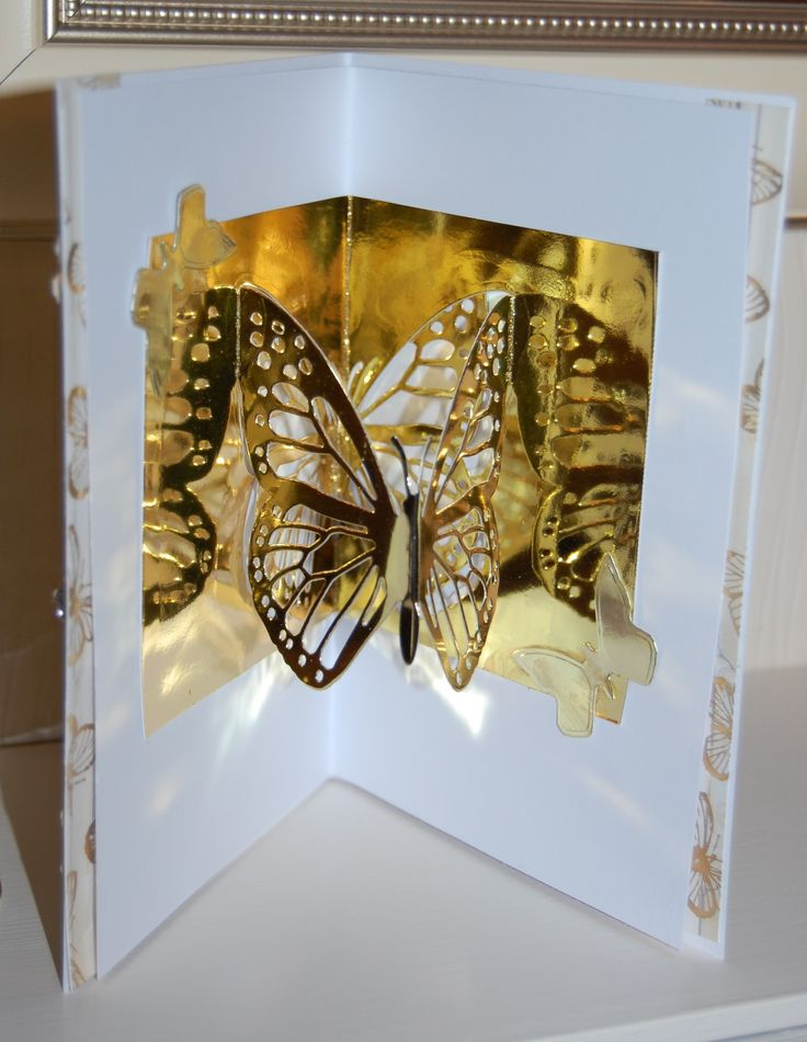 This is a new card using the Couture by Create and Craft The Mariposa dies they cut beautifully I have use the pop up die twice to get the dimension and half of the reflection panel over an embossed panel