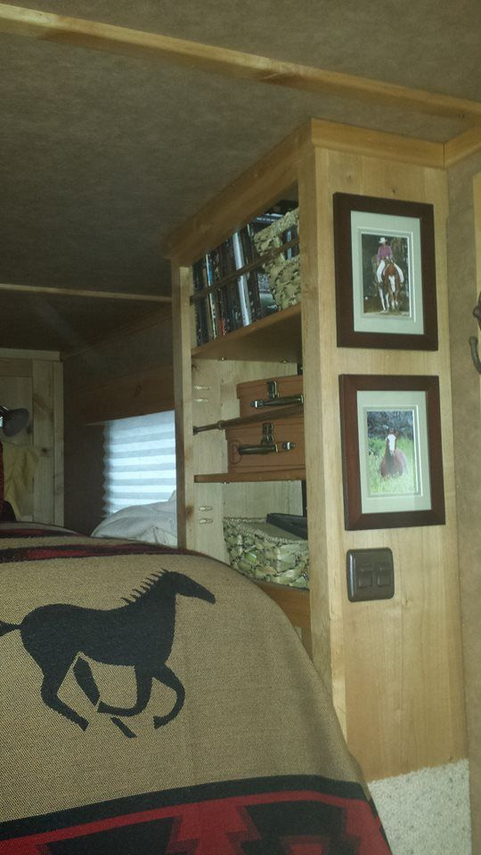 Shelving in bed area of gooseneck horse trailer.  Tension rods to prevent items from falling, pictures hung with command velcro strips  #horse trailer organization