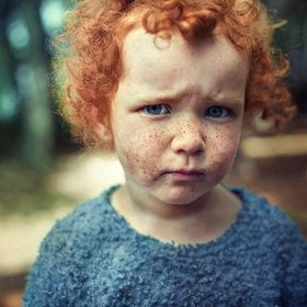 Now that's a ginger. Red hair, red freckles, bright blue eyes, and pale skin. Too cute.