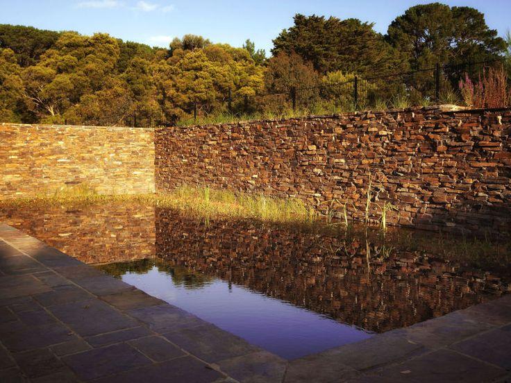 Eco Outdoor Badger drystone walling used around natural swimming pool, design by Eckersley Garden Architecture. | Eco Outdoor | Badger drystone walling | livelifeoutdoors | Outdoor Design | Natural stone walling | Garden design | Outdoor paving | Outdoor design inspiration | Outdoor style | Outdoor ideas | Luxury homes | Paving ideas | Garden ideas | pool ideas | Stone veneer | Stone walling | Stone wall cladding