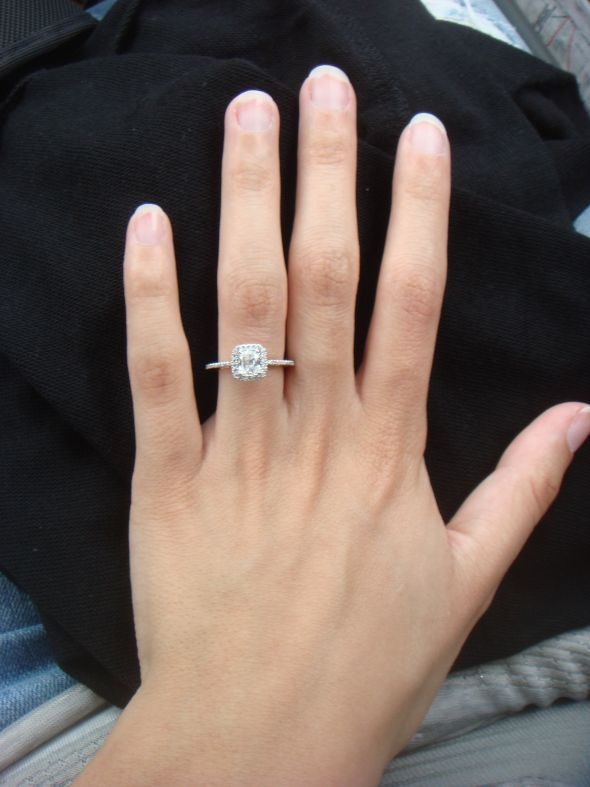 Cushion cut with halo and skinny band. More my size. All these big huge rings are pretty, but would look gaudy on small hands like mine.