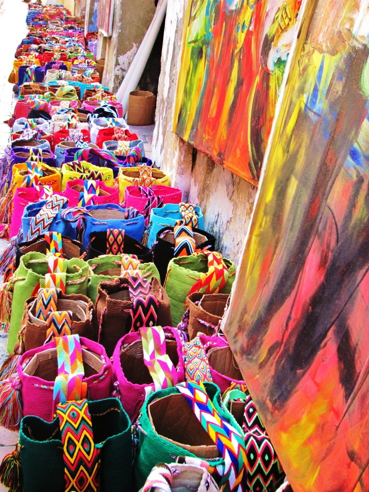 Colorful knitted handbags on the street.
