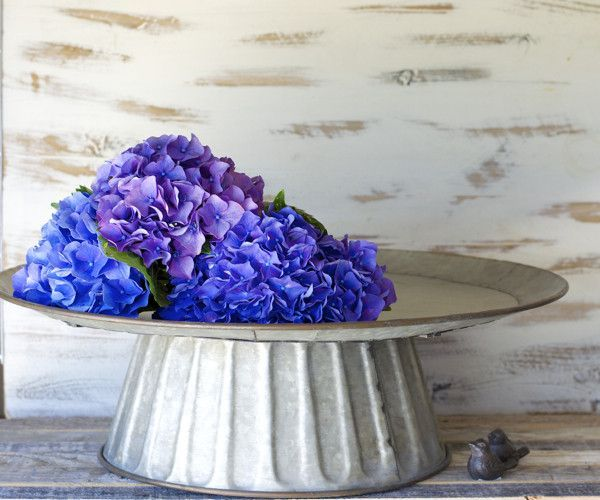 """This huge Embossed Metal Cake Stand is a show stopper! This would be incredible for a Country wedding! - Rustic, worn finish perfect for a farmhouse look - 20""""x 20""""x 6"""""""