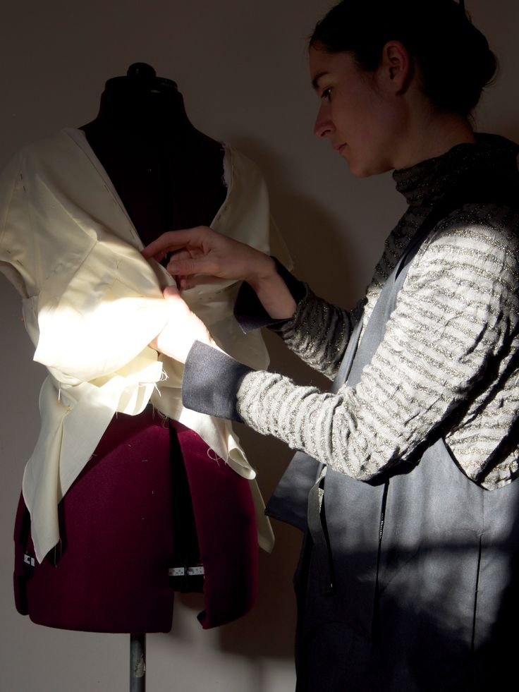 Draping the reclaimed shirt bodice on the dress stand.