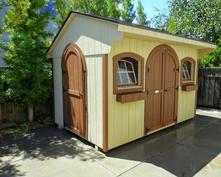 Quaker shed with rounded doors arched windows and flower for Quaker barn home designs
