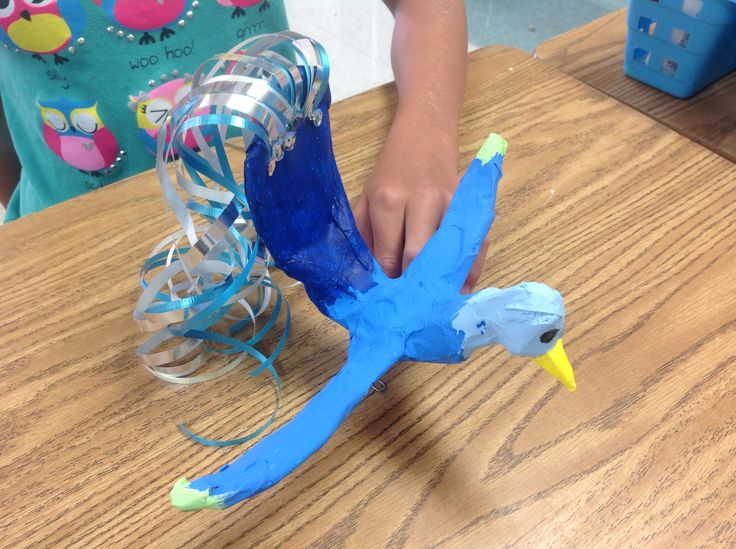 Paper mâché bird created by a 6th grader, was her idea all I did was guide her bit. She used foil and wire for the base. Summer camp 2014