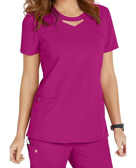 Let your Careisma shine!  The keyhole top from Careisma by Sofia Vergara puts a cute and unique twist on the typical scrub top!  This modern fit scrub top features roomy angled pockets and a removable wristlet inside the right pocket.  The luxurious stretch fabric feels fantastic to wear throughout your shift.  Back princess seams will flatter your shape.   Careisma By Sofia Vergara Fearless Keyhole Scrub Tops  Round neckline with peek-a-boo detail  Two angled pockets  Wristlet inside the…