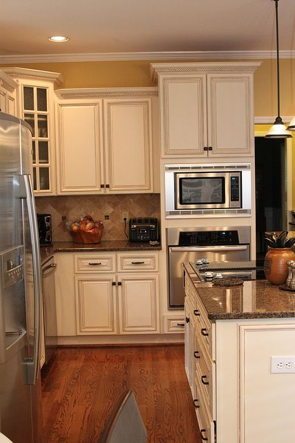 17 best ideas about yellow kitchen cabinets on pinterest for Off white kitchen cabinet paint
