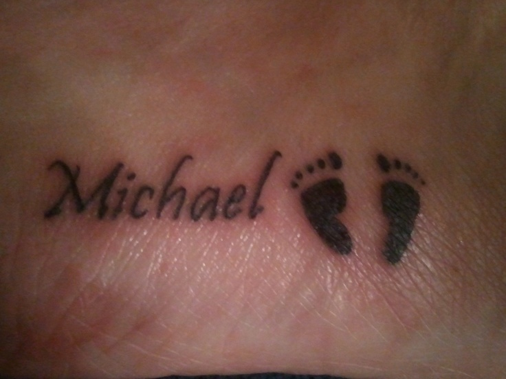 My son Michael's name on the outside of my right foot