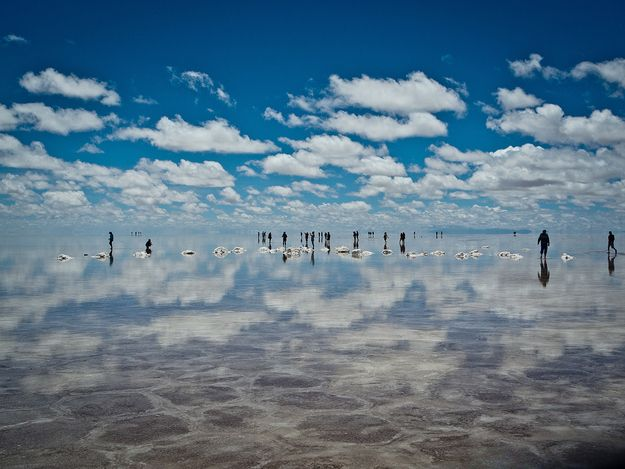 At 4,000 square miles, Salar du Ayuni in Bolivia is the world's largest salt flat and produces surreal reflections when it's covered in water.