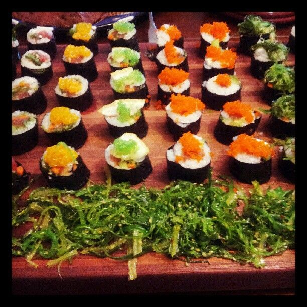 Homemade Sushi, Spicy Rolls with mango, Halibut with Lemon and Green Caviar, shrimp tempura with seaweed salad