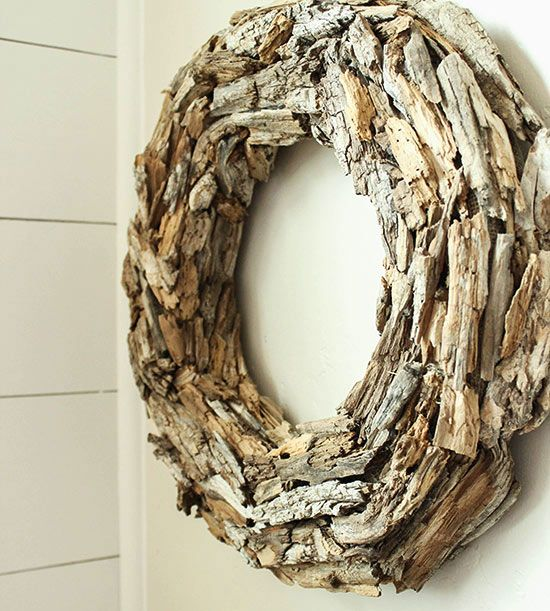 """If you're looking for a neighborhood conversation starter (as in, """"Why, yes, I did create this myself!""""), you've found the wreath for the job. Salvaged driftwood pieces create incredible texture, and variegated wood colors give this wreath can't-look-away appeal. A wreath form and hot glue are the only additional supplies. We also love this wreath for its versatility: Place it on your door, your mantel, or wherever you'd like an edgy, outdoorsy touch./"""
