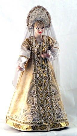 A doll in a festive costume from the Northern provinces of Russia. Fashion of the 19-th century.